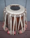 A tabla dayan with a torn head.