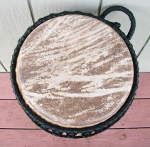 Cow skin drum head of an ashiko.