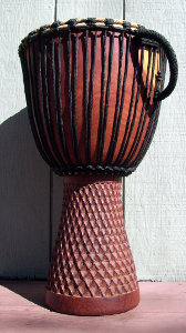 African jembe drum in need of a drum head.
