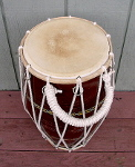 Dholak hand drum that has had its tuning rope replaced.