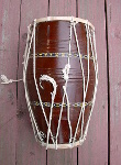 Dholak hand drum with old, broken rope.