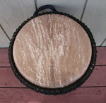 African djembe hand drum with a fresh goat skin drum head.