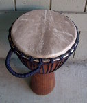 African djembe from Gambia with a ripped drum head.