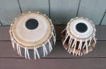 Newly rebuilt tabla set with new tasmas, gattas and pudis.