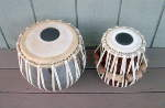 Newly reconditioned tabla set with new straps, tuning pegs and drum heads.
