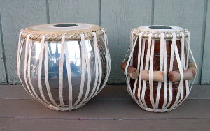 Just rebuilt tabla set with new straps, tuning pegs and drum heads.