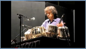 Musician playing several tablas.