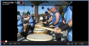 Taiko drummers drumming.